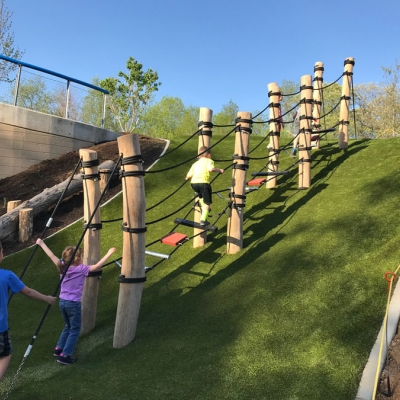 Kids climb an obstacle course